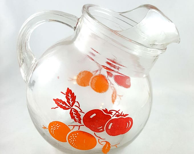 Adorable little Tilted Ball Glass Juice Pitcher