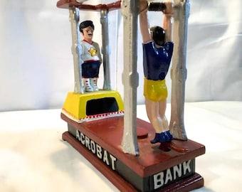 Classic Cast Iron Mechanical Bank. 2 Acrobats kick coin into bank slot.