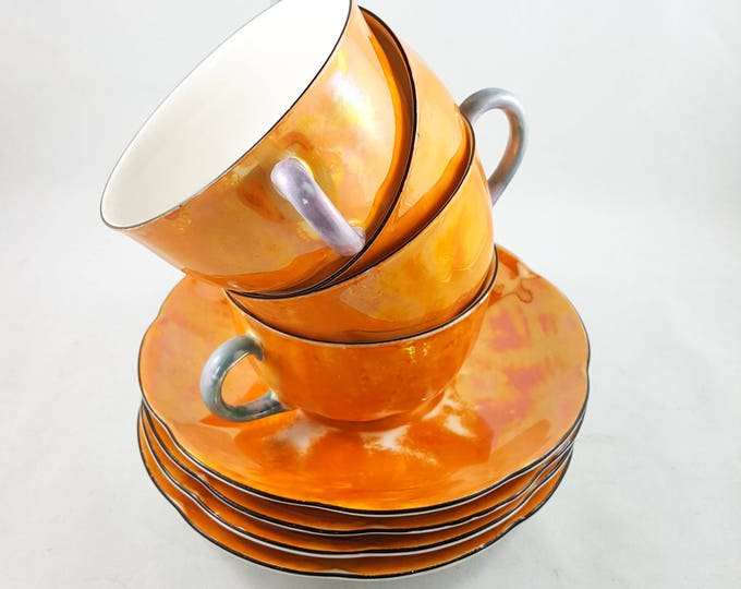 Absolutely Gorgeous Iridescent Peach/Orange Lustreware Cup and Saucer Set