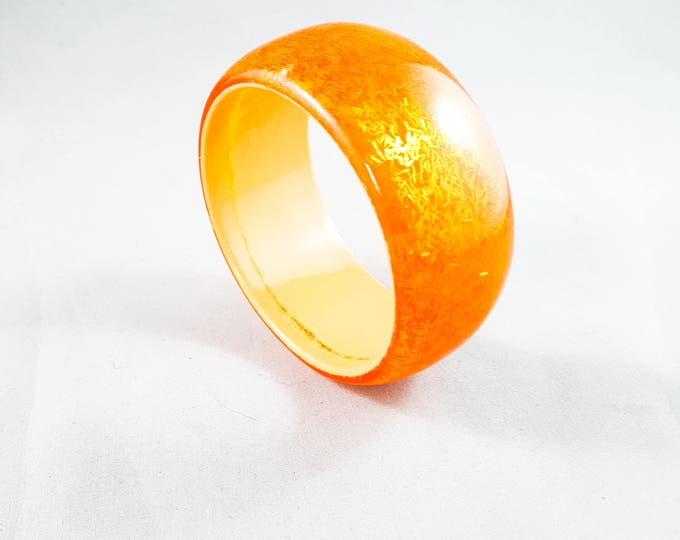 Stunning Acrylic Bangle in Orange with Cream Interior and encased red sparkle