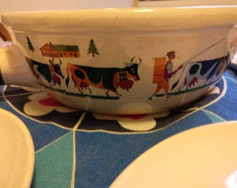 Vintage 60s 70s Switzerland Landert Fondue set, includes ceramic pan, six plates plus one larger plate.