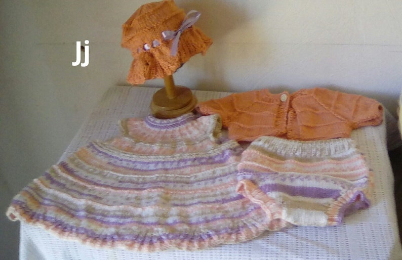 Hand knitted baby dress, pants, cardigan and bonnet to fit up to 3 months