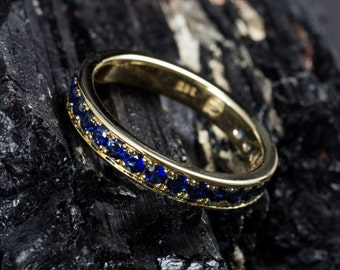 Memoryring/Alliance ring of 585 gold with blue sapphires