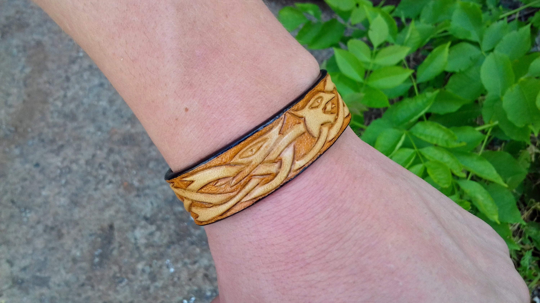 Celtic dragon leather bracelet Leather carving Knot work   Etsy