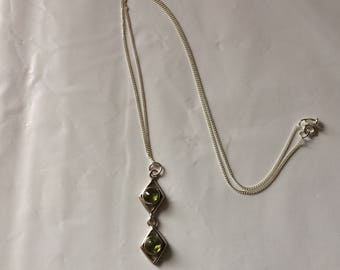 Peridot and silver pendant necklace