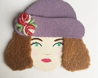 Calais lace brooch with leather and Flower hat woman face