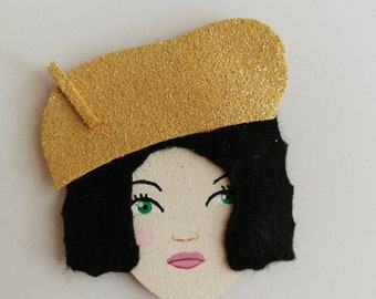 Brooch with shiny Golden leather Hat woman face
