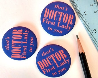 """Pin-back button: """"that's DOCTOR First Lady to you"""" in 1.75 inch velvet matte finish"""