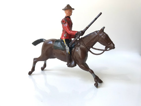 Canadian Mountie RCMP on Horse with Bugle