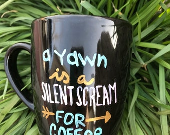 Silent scream coffee mug.