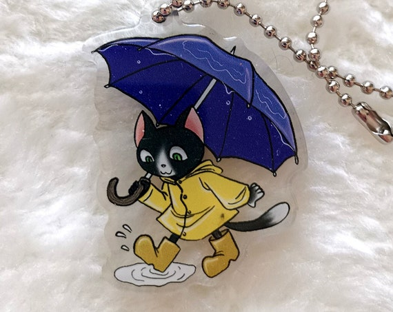 Cute raincoat cat with an umbrella keychain charm