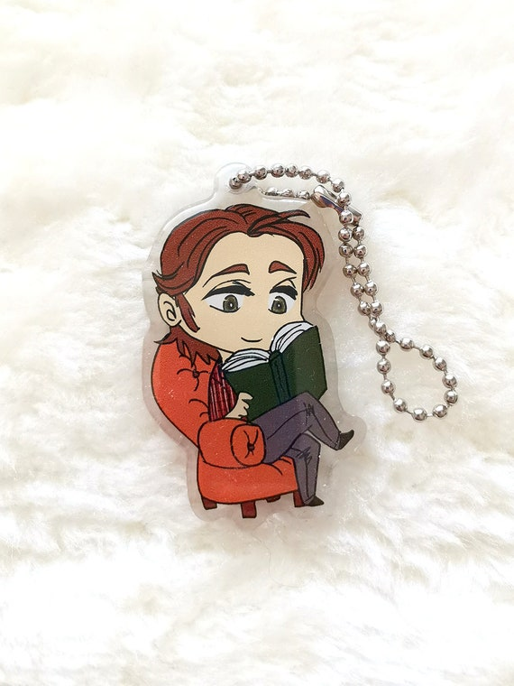 Supernatural charm keychain chibi Sam reading a book