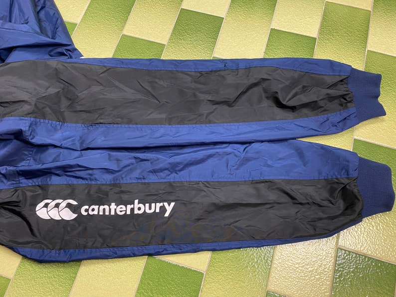 Canterbury Rugby Full Zip Packable Hooded Windbreaker Jacket Fits a L-XL