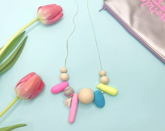 Asymmetrical and original necklace with natural wood balls and