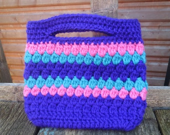 Hand crocheted cute Handbag in purple, pink and turquoise