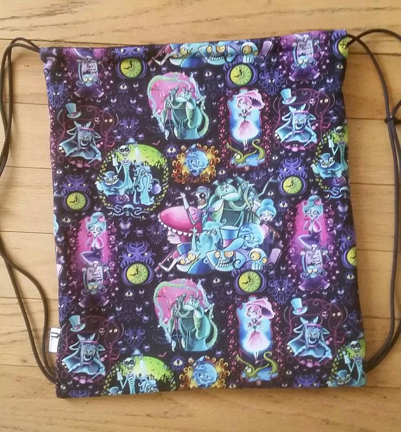78672366f31 Haunted Mansion drawstring backpack Halloween bag