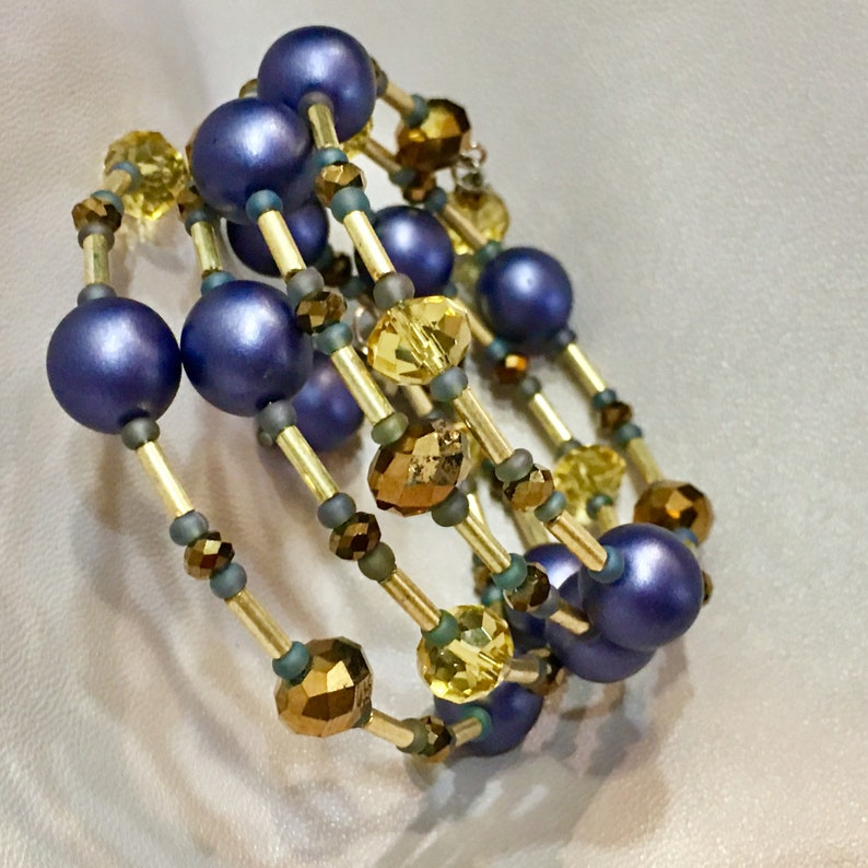 Purple Pearl and yellow and Brown Crystalvmemory wire Bracelet hand made Killer Jewelry