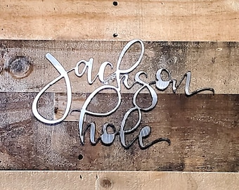 Metal JACKSON HOLE spring decor hand ground using recycled materials.