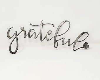 Metal GRATEFUL spring decor hand ground using recycled materials.
