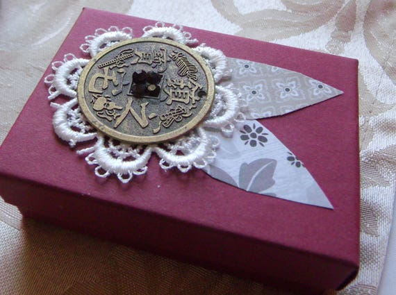 Burgundy gift box - white lace flowers - Chinese brass coin decor - rhinestone iridescent ruby - floral paper leaves - chandelier charm