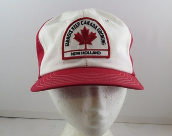 5f1131046b8ce Vintage Patched Farmer Hat - New Holland Tractors Canada - Adult Snapback