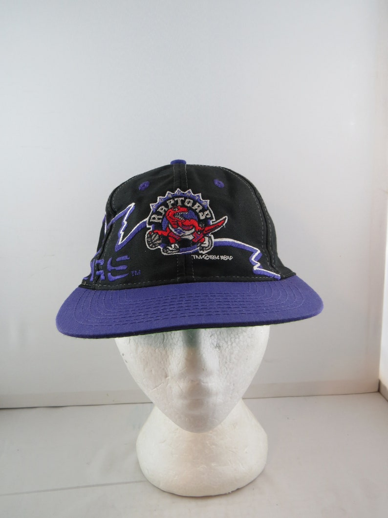 d039f80ed12 Toronto Raptors Hat VTG Thunderbolt with Original Logo   Etsy