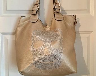 87f9775b83 Metallic Gold crystal embellished skull slouch shoulder bag