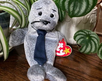 TY:    Slippery, January 17, 1998      Excellent condition Beanie Baby, wearing a tie, with original tags.  Free Delivery