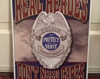 """COLLECTIBLE EMBOSSED METAL SIGN /""""REAL HEROES DON/'T WEAR CAPES/"""" POLICE"""