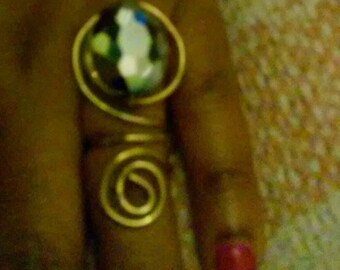 Gold swirl ring