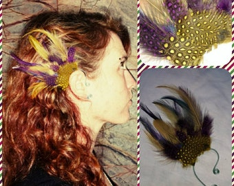 Right ear. Handmade purple, yellow and blue feather ear cuff