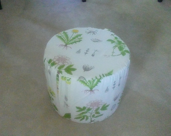 Soft Pouf/footstool with washable cover.
