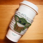 The Green Alien Child Baby Coffee Cup Cozy / Crochet Coffee Sleeve / Reusable Cozie / Customizable