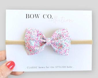 67acd594ac6a Cupcake Sprinkles Glitter Bow Headband