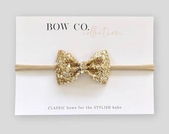 0357a728ddea Gold Mini Glitter Bow Headband
