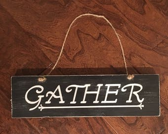 Gather wood hanging sign
