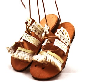Gladiator sandals with pom pom ~ decorated with lace.