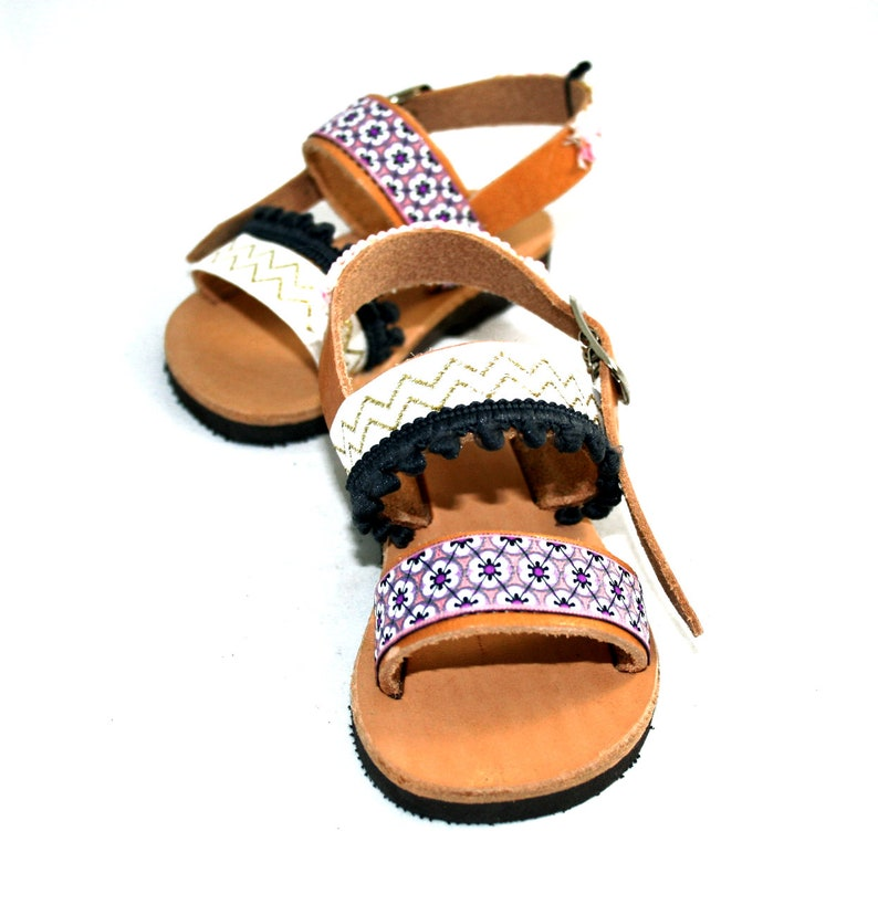 86de77ce6819 Shoes baby girl Baby gladiator sandals with pom poms made of