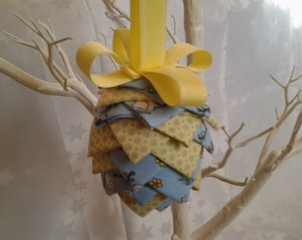 Hanging fabric pine cone in pale blue and yellow