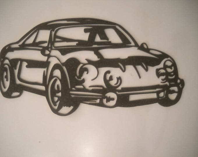Plate teaches RENAULT ALPINE A110 in painted iron