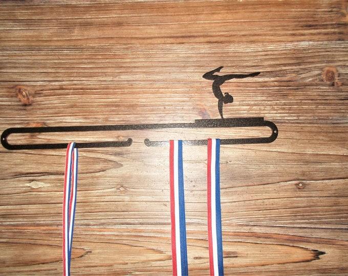 Hanging medal female gymnastics themed
