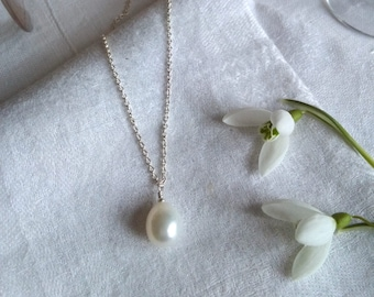Single large white freshwater drop pearl on sterling silver