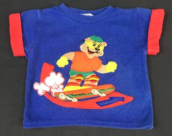 Vintage baby skater design embroidery knit t-shirt in royal blue with red lined fold up sleeves from the 1980's, Size 24 months