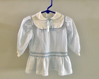 Vintage Polly Flinders baby dress in blue and white knit with smocking, peter pan collar yoke and ribbon from the 1980's, Size 24 Months