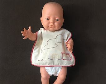 Handmade 1950's darling baby bib with red trim and train embroidery for vintage style nursery decor or baby photo shoot