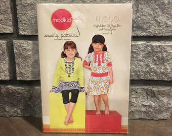 Girls yoga skirt and ruffled shirt sewing pattern by ModKid Maya unopened and uncut, Sizes 2T to 8, by designer Patty Young