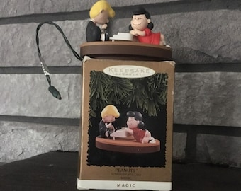 1996 Hallmark Keepsake Christmas ornament Peanuts Schroeder and Lucy Music, plugs into lights plays Linus and Lucy song from Peanuts gang