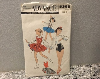 Girl's skating and dance vintage costume pattern size 8 Advance 8385 from 1960's, makes circle skirt & suspenders, blouse, weskit and shorts