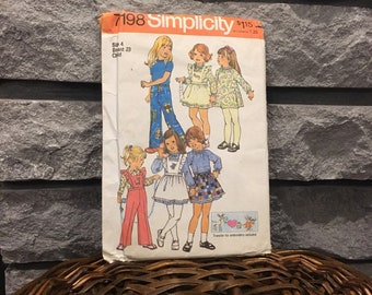 Girls dress pattern with pinafore and pants, vintage 1975 Simplicity 7198 size 4, detachable ruffled bib on pants or pinafore, raglan sleeve