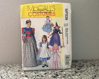 Alice in Wonderland or Oz costumes pattern for Halloween or Party McCall's M4948 Dorothy, Witch, Queen of Hearts  Misses sizes Sml-Xlg UNCUT